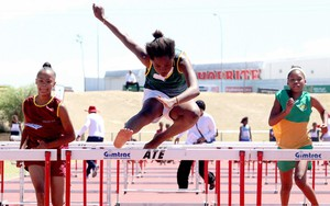 Photo of girl doing hurdles