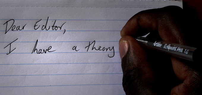 Photo of hand writing a letter