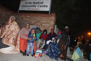 Photo of queue in night at SASSA paypoint