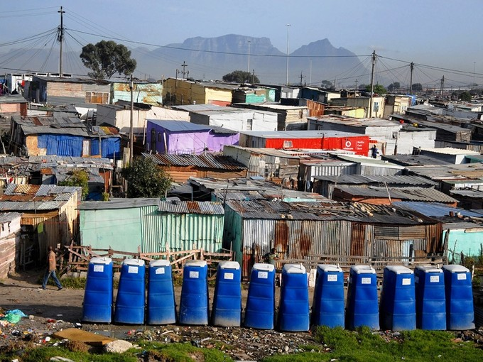 Photo of a row of blue portable toilets
