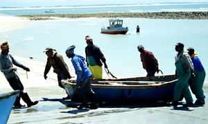 Photo of fishermen in the sea