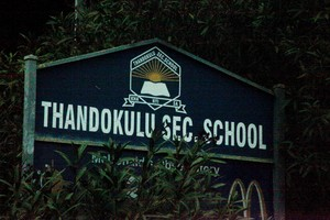 Photo of sign of Thandokhulu Secondary School