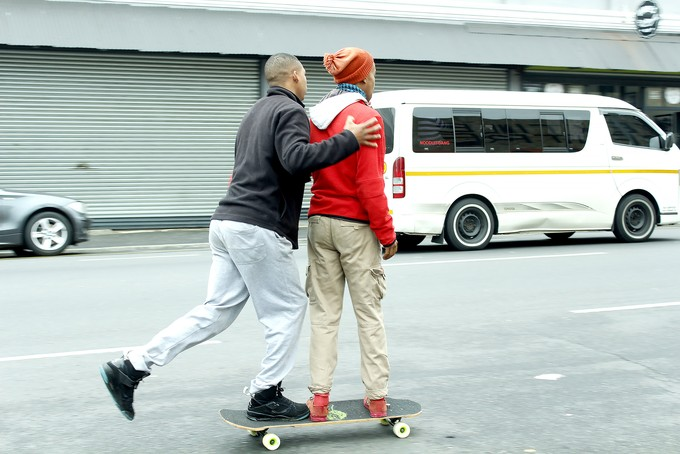 Photo of two boys skateboarding
