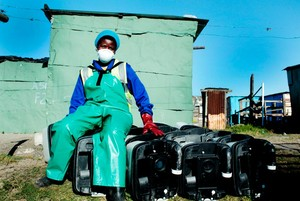 Photo of worker sitting with portable toilets