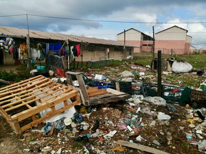 Photo of school grounds strewn with rubbish
