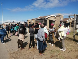 Photo of people standing outside the clinic