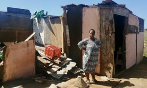 Photo of a woman and a shack