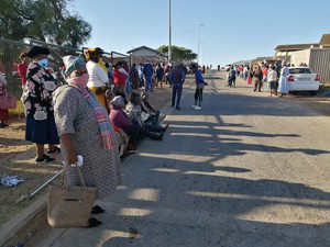 Photo of people outside the clinic