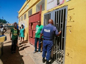 Photo of police at. spaza shop