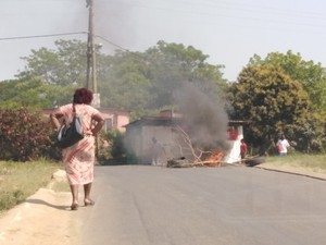 Photo of burning wood in road