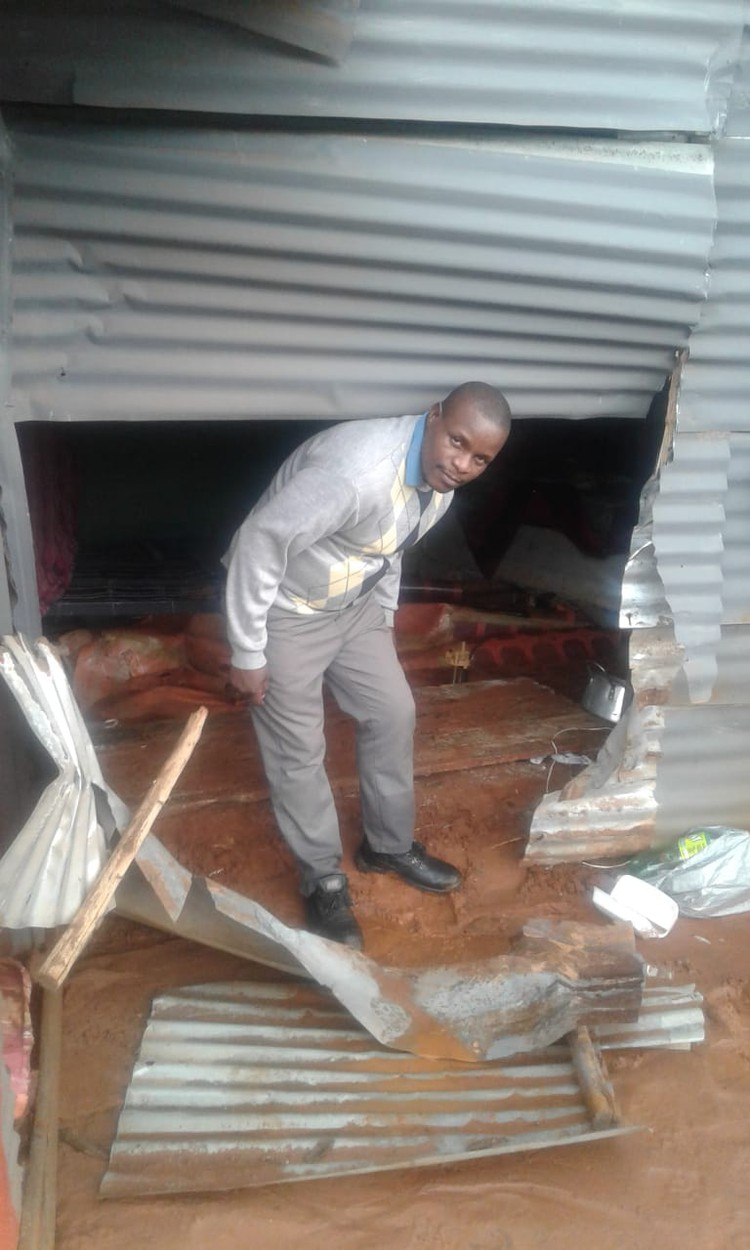 Photo of man with broken shack