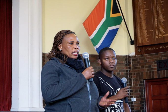 Photo of two women speaking at public meeting