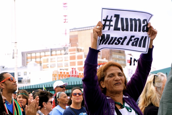 Photo of woman holding Zuma Must Fall placard