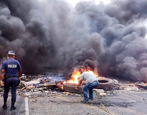 Photo of a protest with burning tyres