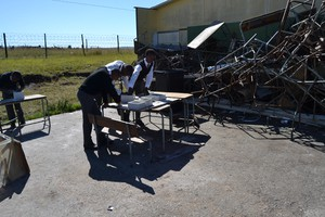 Photo of students in destroyed classroom