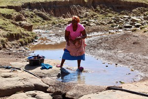 Photo of a woman doing washing