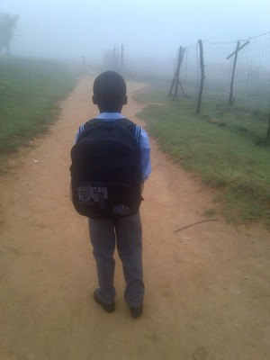 Photo of school child walking into mist