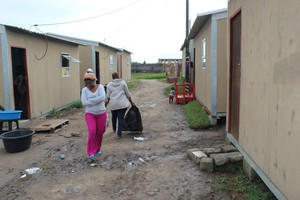 Photo of a lane between prefab houses