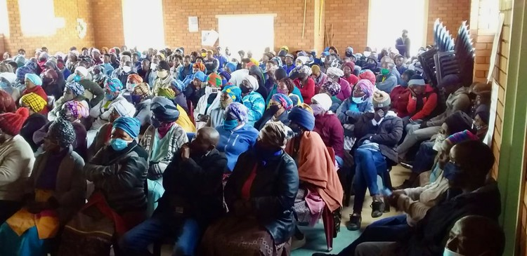 Photo of a community meeting in a hall