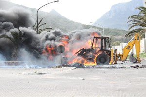 Photo of burning construction vehicle