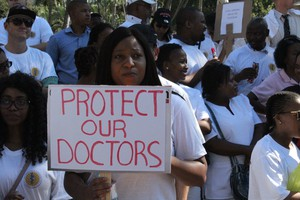Photo of health worker with sign