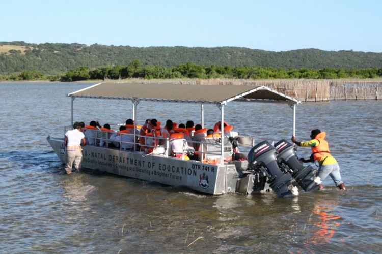 Photo of school children in a boat