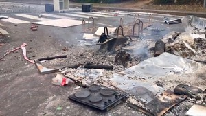 Photo of burnt stove and debris