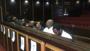 Photo of men in court