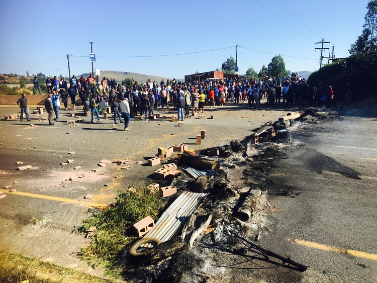 Photo of protesters and blocked road