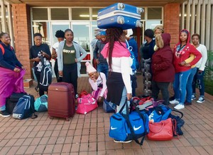 Photo of a group of students with bags