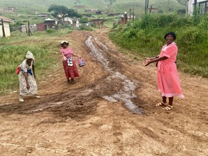 Photo of three women on a dirt road