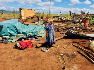 Photo of a woman standing in debris
