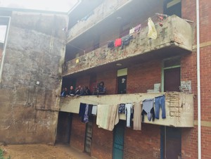Photo of the court convoy standing in one of the hostel blocks