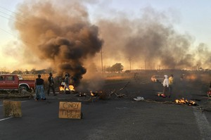 Photo of residents blocking roads with burning tyres