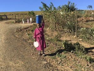 Photo of woman carrying water
