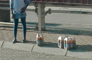 Photo of beer containers on the pavement