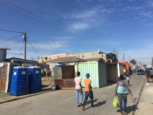 Photo of shipping containers and people