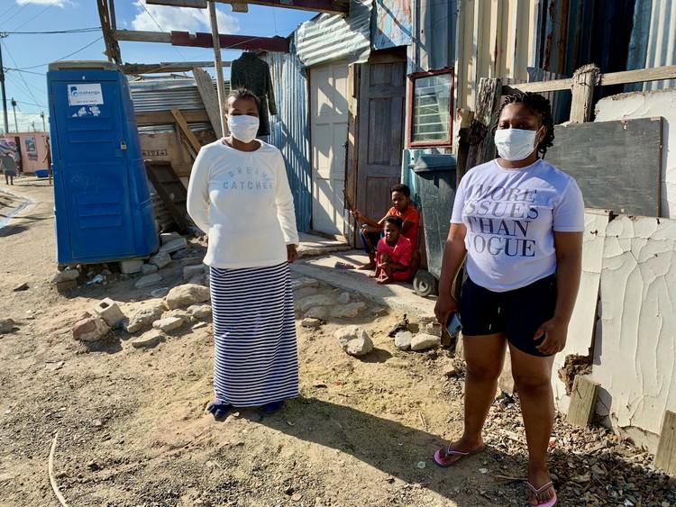 Photo of two women in an informal settlement