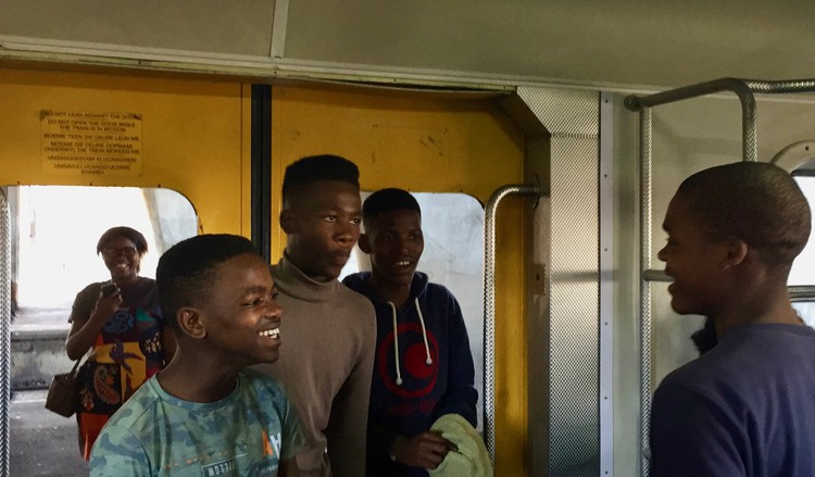 Photo of four youngsters in a train