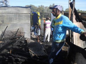 Photo of man at burned out shack