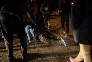 Photo of man being beaten