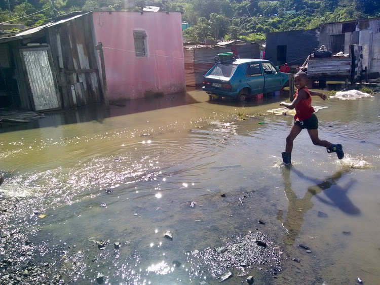 Photo of flooded are and a child running