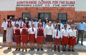 Photo of learners in front of a school