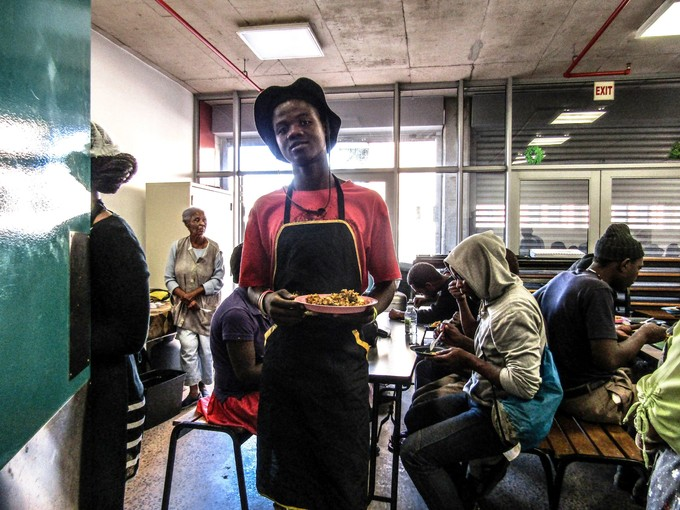Photo of a young man working in a soup kitchen