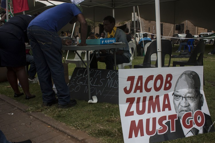 Photo of Zuma must go poster and people signing petition
