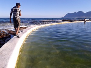 Photo of boy and tidal pool
