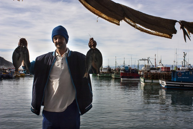 Photo of man holding up fish
