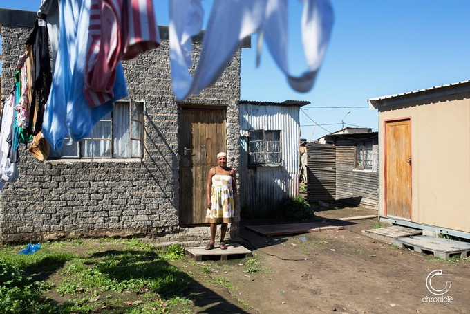 Photo of a woman in a yard with washing