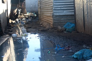 Photo of shacks in water