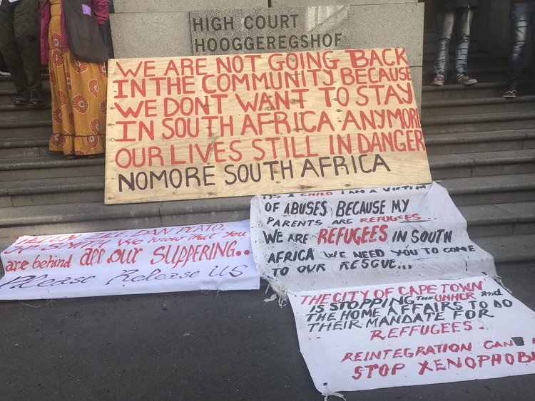Photo of refugee protest placards outside Cape High Court